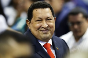 Venezuelan President Chavez arrives to receive his certificate as president-elect, from the national electoral council in Caracas